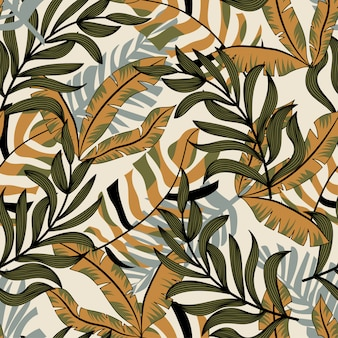 Trend abstract seamless pattern with colorful tropical leaves and plants on pastel background