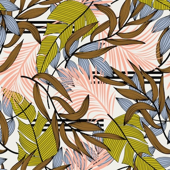 Trend abstract seamless pattern with colorful tropical leaves and plants