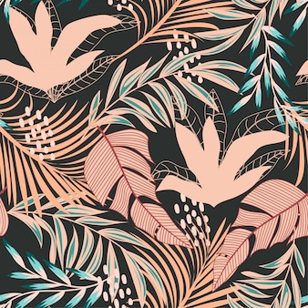 Trend abstract seamless pattern with colorful tropical leaves