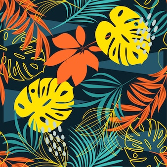 Trend seamless pattern with colorful tropical leaves and plants on blue