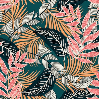 Trend seamless pattern with colorful tropical leaves and plants on green background