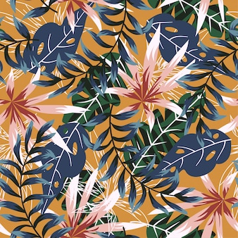 Trend seamless pattern with colorful tropical leaves and plants on orange background