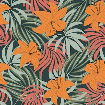 Trending abstract seamless pattern with colorful tropical leaves and flowers on grey background