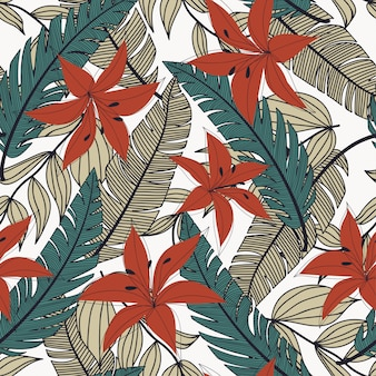 Trending abstract seamless pattern with colorful tropical leaves and flowers on white background