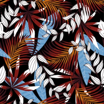 Trending abstract seamless pattern with colorful tropical leaves and plants on black