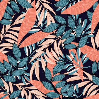 Trending abstract seamless pattern with colorful tropical leaves and plants on blue background