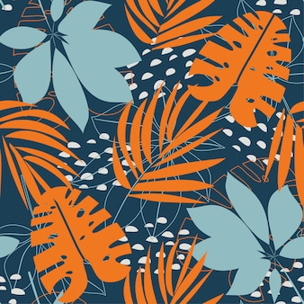 Trending abstract seamless pattern with colorful tropical leaves and plants on blue