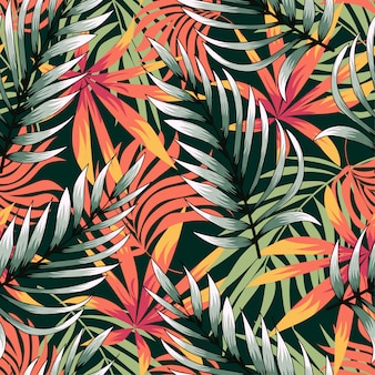 Trending abstract seamless pattern with colorful tropical leaves and plants on green background