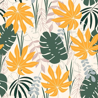 A trending abstract seamless pattern with tropical leaves