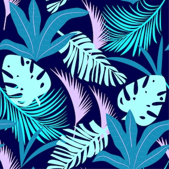 Trending bright seamless pattern with colorful tropical leaves and plants on purple background