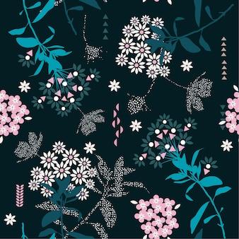 トレンディな幾何学的な花のミックスと庭の葉