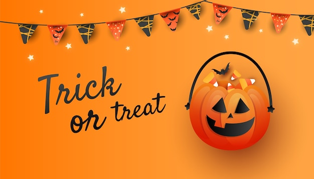 パステルオレンジ色の背景にオレンジ色のカボチャ、キャンディー、コウモリとトレンディな最小限のハロウィーンのポスター。フラットレイ、テキスト用のコピースペースを備えた上面図。