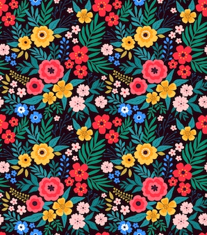 Trendy seamless floral pattern with bright colorful flowers and leaves on a dark blue background.