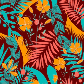Trendy seamless pattern with colorful tropical leaves and flowers