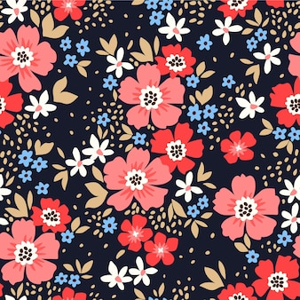 Trendy seamless vector floral pattern seamless print small pink and red flowers black background