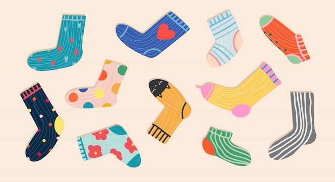 Trendy socks seamless pattern. cozy hand-drawn cartoon style socks on a pastel pink background. variety of funny socks. modern   for stationery, textile and web use. trendy apparel.