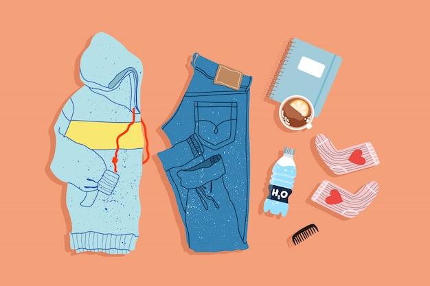 Модный спортивный костюм сверху вниз. рисованной instagram стиль заложить иллюстрации. современные балахон, джинсы, носки и записная книжка на простой фон. объекты есть.