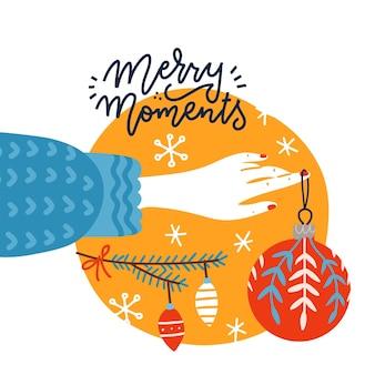 크리스마스 장난감을 들고 있는 여성의 손이 있는 세련된 정사각형 인사말 엽서는 크리스마스 트리를 장식합니다...