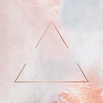 Triangle copper frame on pastel background