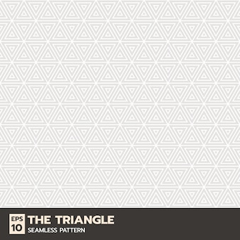 三角形または幾何学的な線のシームレスなパターン