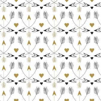 部族の矢のシームレスなパターン。エスニックスタイルのベクトルプリントデザイン。ヴィンテージの金色と黒の模様
