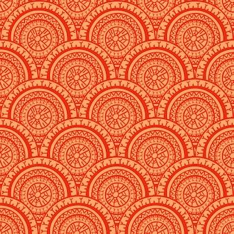 部族の美しい抽象的なシームレスな赤とオレンジの丸い模様