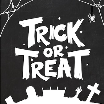 Trick or treat in black and white halloween lettering