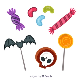 Trick or treat candies for halloween on white background