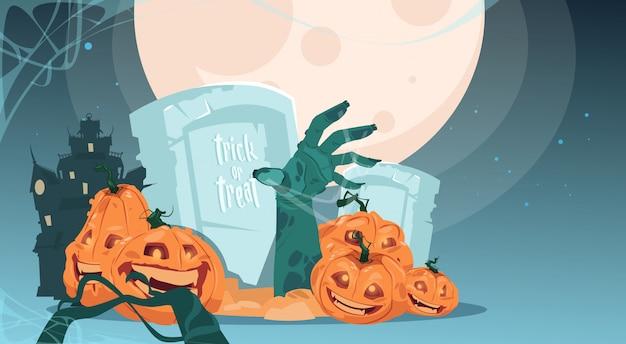 Trick or treat. happy halloween. pumpkins on cemetery