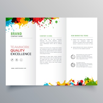 Trifold business brochure template with colorful paint stains