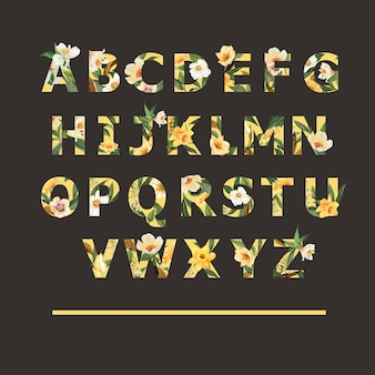 Tropical alphabet serif font yellow typographic summer with plants foliage
