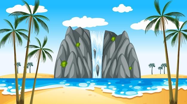 滝のある昼間のシーンで熱帯のビーチの風景
