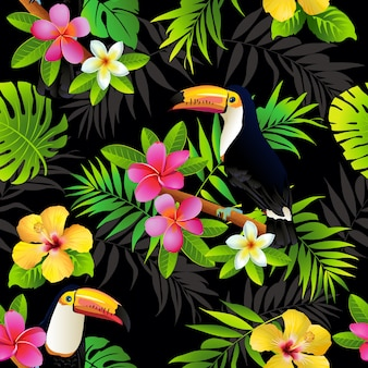 Tropical birds toucans and palm leaves seamless background.