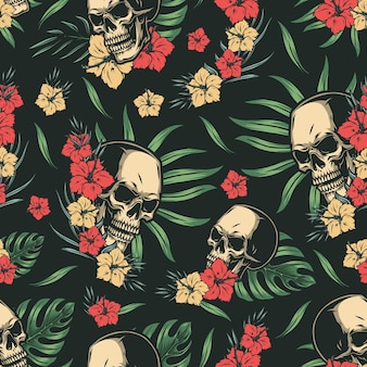 Tropical colorful seamless pattern with skulls, hibiscus flowers, palm and monstera leaves