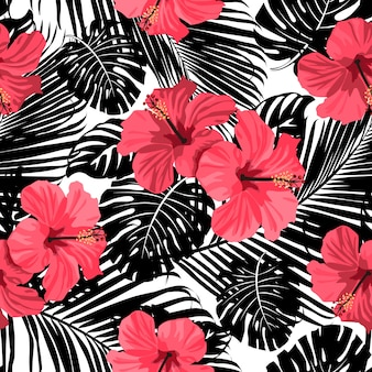 Tropical coral flowers and leaves on black and white background. Seamless.