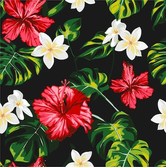 熱帯の花とヤシの葉のシームレスなパターン
