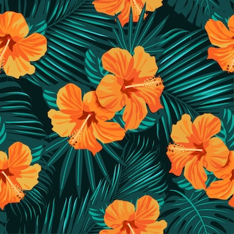 Tropical flowers and palm leaves seamless pattern.