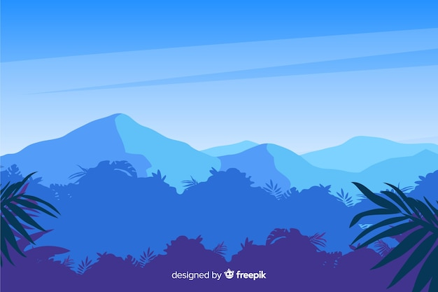 Tropical forest landscape with blue mountains