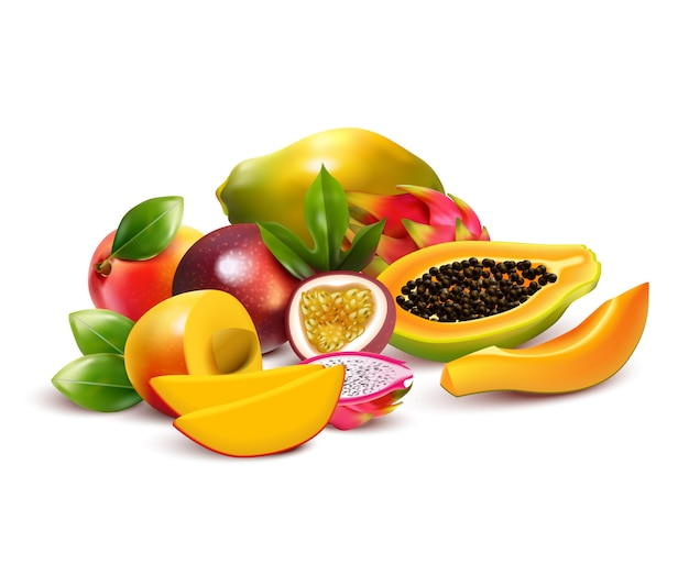 Tropical fruits composition with pitaya mango dragon fruit cut up and ripe with leaves in a bunch
