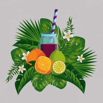 Tropical fruits with beverage in the exotic flowers and leaves
