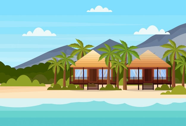 Tropical island with villas bungalow hotel on beach seaside mountain green palms landscape summer vacation flat