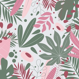 Tropical leaves and flowers on beige background