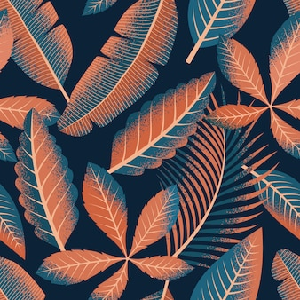 Tropical leaves seamless pattern on dark background.