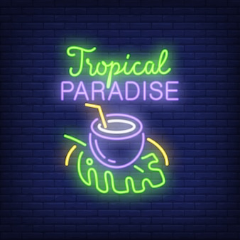 Tropical paradise lettering with coconut drink on leaf.
