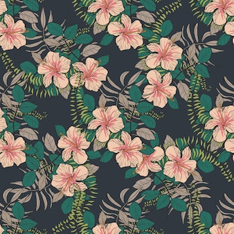 Tropical pattern with hibiscus flowers and leaves.