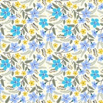 Tropical seamless floral pattern with bright colorful flowers and leaves on a white background.