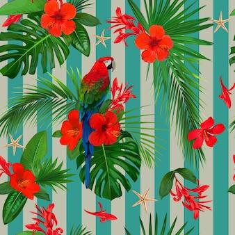 赤い花とオウムのコンゴウインコと熱帯のシームレスなパターン