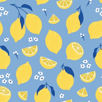 Tropical seamless pattern with yellow lemons. summer print with citrus, lemons slices, fresh fruits and flowers in hand drawn style.