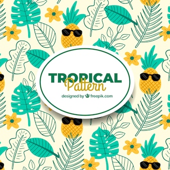 Tropical summer pattern with plants and pineapples