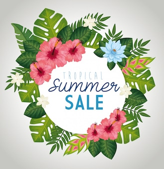Tropical summer sale with frame of leafs and flowers